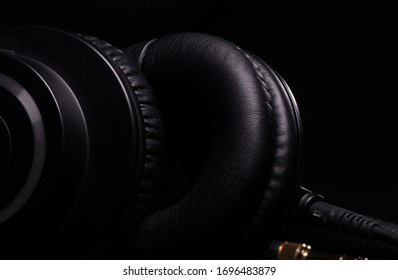 Beautiful details of professional studio headphones close-up on a black background