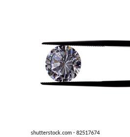 beautiful diamond being held by tweezers.