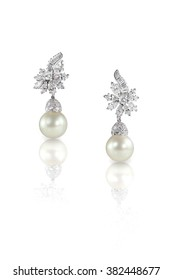 Beautiful Diamond pearl Marquise drop dangle earrings studs pair isolated on white with a reflection