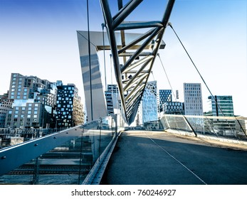 Beautiful different modern buildings,  bridge from Oslo's Barcode district rises from the fjord like an urban and super trendy in Norway. 22 November 2017, Oslo Norway