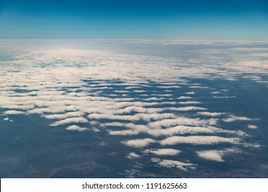 Beautiful different types clouds from ariel shooting. Flight high view from stratosphere. Background is blue sky. Cumulus, stratus, altocumulus, altostratus, cumulonimbus type of clouds.