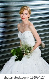 Beautiful Dirty Blonde With Long Hair In Classic Up-do Posing on Her Wedding Day