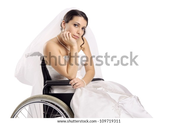 Beautiful disabled bride posing in a wheelchair