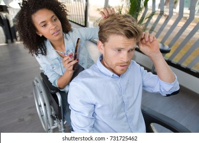 beautiful disabled hairdresser cutting handsome mans hair