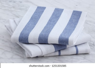 beautiful dish towels on carrara marble countertop