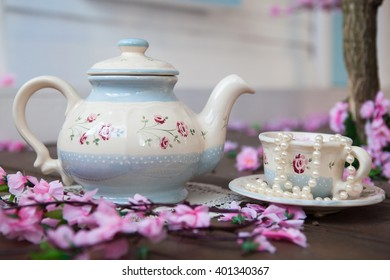 beautiful dishes with flowers tea set, teapot and cup in cherry colors