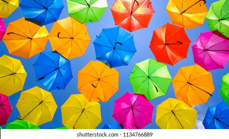 Beautiful display of colorful hanging umbrellas in a outdoor plaza in Miami.