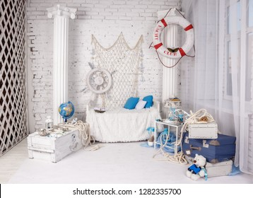 Beautiful diverse location in Studio in marine style in white for a photo shoot on a brick wall. Interior design in loft style in classical antique style with structural columns in empty apartment.