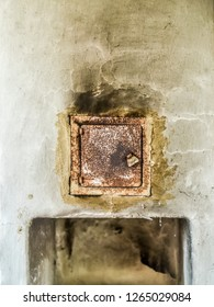 Beautiful and diverse subject. Beautiful and original texture of the wall of the stove and the door for logs and puff in the country house and utensils in the afternoon.