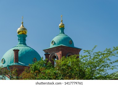 Beautiful domes of the Orthodox church against the blue sky. Resurrection skete of the Valaam Monastery. Church of the Resurrection of Christ. Valaam Island. Karelia. Russia.