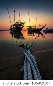 Beautiful dramatic cloud scene background with tied boat at Dammam Sea side at Saudi Arabia.