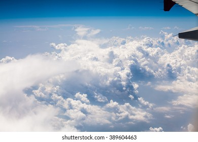 Beautiful, dramatic clouds and sky viewed from the plane. High resolution and quality