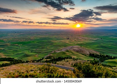 Beautiful and Dramatic Palouse, Washington, Summer Sunrise. The rolling hills of the Palouse area of eastern Washington as seen from the famous Steptoe Butte State Park-a photographic paradise.