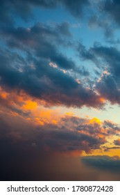 Beautiful dramatic sky. Sunset or sunrise time. Amazing purple clouds. Vertical photo.