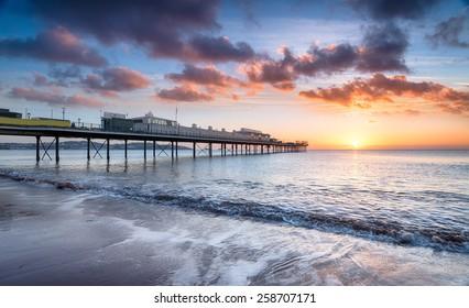 Beautiful dramatic sunrise at Paignton pier in Devon
