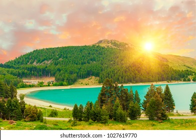 Beautiful dramatic sunset over the incredibly blue lake Tekapo. Canterbury region, New Zealand