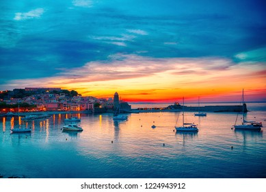 Beautiful dramatic sunset sky over small bay of Collioure, coastal village in the south of France.