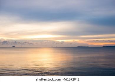 Beautiful dramatic sunset sunrise twilight time sky over the sea reflect on surface of ocean.