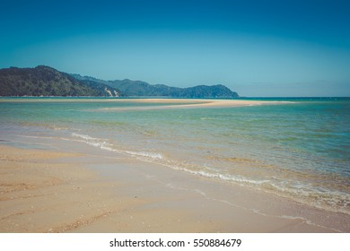 Beautiful dreamy ocean landscape with clear turquoise ocean water and white sandy beach,  Abel Tasman National Park, New Zealand South Island
