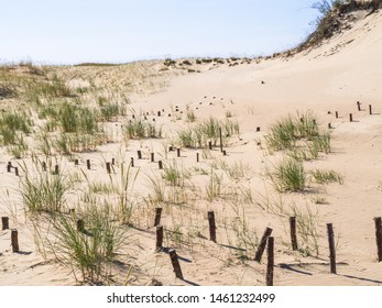 Beautiful Dune at Curonian Spit near Nida, Neringa, Lithuania, awesome nature summer landscape with lot of sand, blue sky, dry grass and Baltic Sea