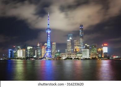 Beautiful dusk scene of shanghai skyline and huangpu river at night, China