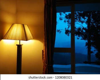 Beautiful dusk view from window, showing a beautiful comparison between natural and artificial light of man made world.