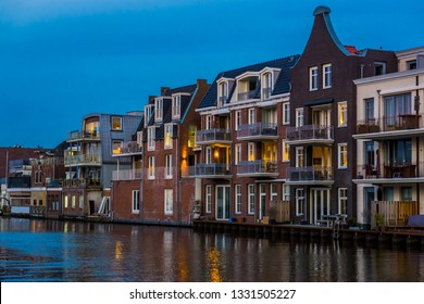 beautiful dutch city architecture by night, luxurious houses with balconies, Alphen aan den Rijn, The Netherlands