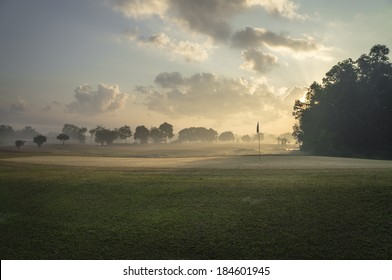 Beautiful early morning golf course in the sunrise