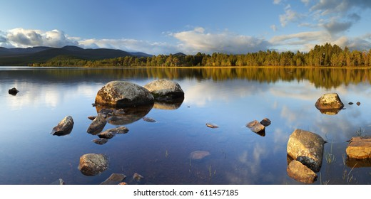 Beautiful early morning light over a tranquil lake. Photographed at Loch Morlich, Cairngorms, Scotland.