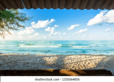Beautiful early morning sunrise over and Wave of the sea on the sand beach the horizon at Hat chao lao beach in Chanthaburi Thailand.Looking through the roof