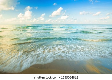 Beautiful early morning sunrise over and Wave of the sea on the sand beach the horizon at Hat chao lao beach in Chanthaburi Thailand.
