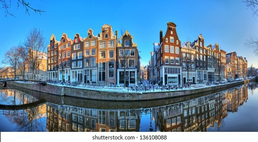 Beautiful early morning winter panorama of the Unesco world heritage city canals of Amsterdam, The Netherlands. HDR