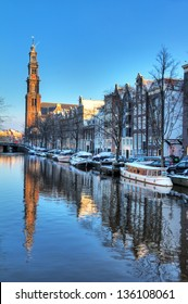 Beautiful early morning winter view on the Westerkerk and the Prinsengracht, one of the Unesco world heritage city canals of Amsterdam, The Netherlands. HDR