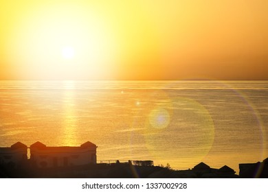 Beautiful early sunset on the sea background