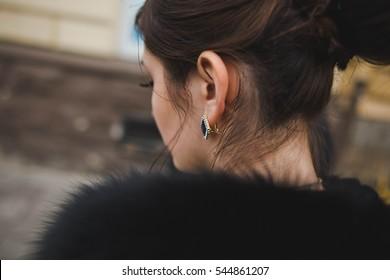 beautiful earring with black stone on ear of women