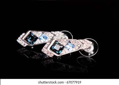 Beautiful earrings with  gems on black background