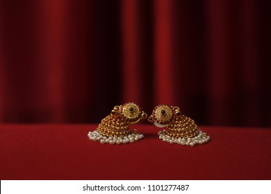 beautiful earrings in a jhumka style arranged in a unique style