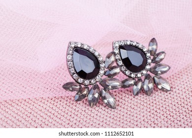 Beautiful earrings  on a pink background