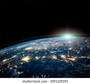 Beautiful Earth space view by night with sun on horizon with copyspace. Science background. Elements of this photo furnished by NASA.
