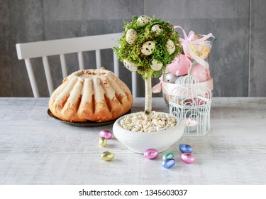 Beautiful Easter decoration in tree shape with moss and quail eggs.