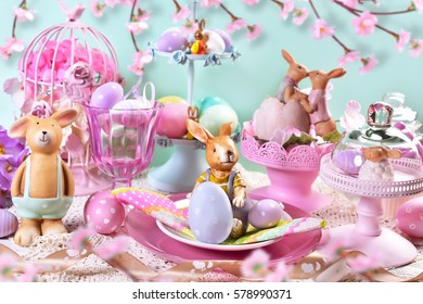 beautiful easter table decoration with painted eggs ,rabbits and flowers in pastel colors