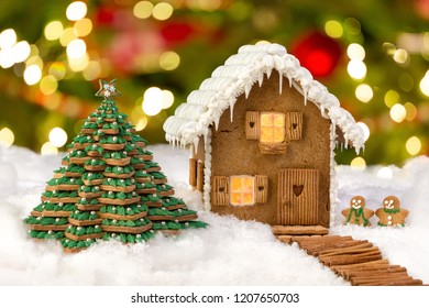 Beautiful edible gingerbread cookie house in a snowy landscape - can be used as template for baby composites
