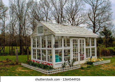 Beautiful Edwardian Style Greenhouse with picket fence and flowers