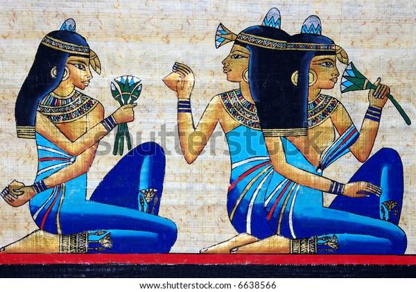 beautiful egiptian papyrus - three girls holding a lotus flower - beauty concept