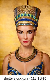 Beautiful Egyptian woman on the huge golden gates background