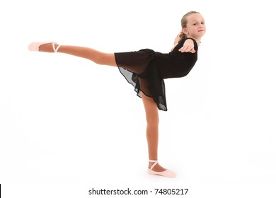 Beautiful eight year old caucasian girl ballerina dancer with clipping path over white.