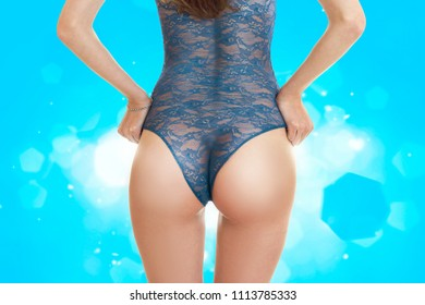 beautiful elastic buttocks in blue lace Bodysuit in studio