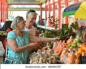 beautiful elderly couple in  market