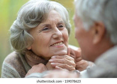 beautiful elderly couple on the background of autumn leaves