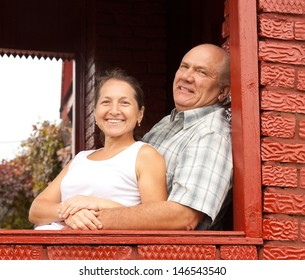 beautiful elderly couple on the porch